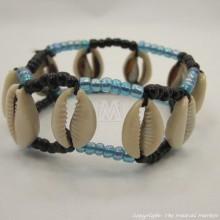 Maasai Cowrie Shells Elastic Bracelet (iridescent blue and black maasai beads)